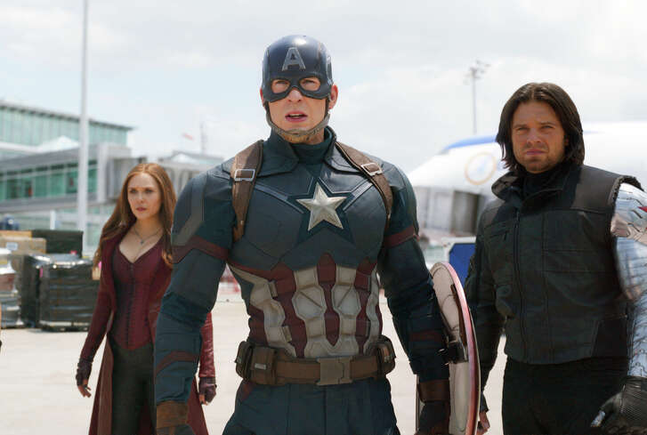 "This image released by Disney shows Elizabeth Olsen, left, Chris Evans and Sebastian Stan in a scene from Marvel's ""Captain America: Civil War,"" opening in theaters nationwide on May 6, 2016. (Disney/Marvel via AP)"