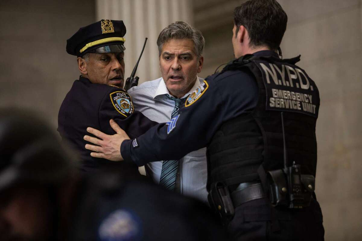 """This image released by Sony Pictures shows George Clooney in a scene from """"Money Monster,"""" opening in theaters nationwide on May 13. (Atsushi Nishijima/Sony Pictures via AP)"""