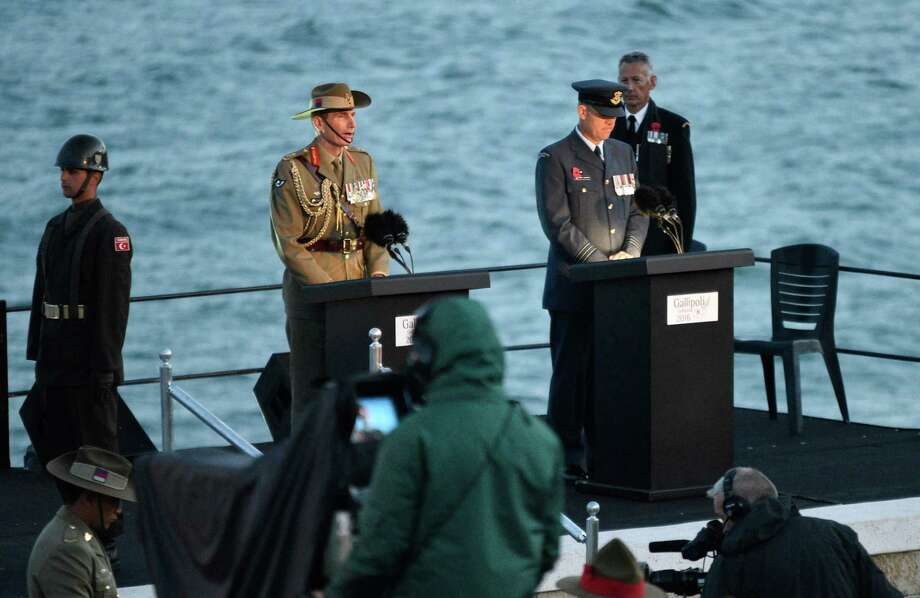 Members of various military services speak at a dawn service for Anzac Day in Gallipoli on April 25, 2016, to mark the 101st anniversary of the ill-fated Gallipoli campaign in World War I. Turkey and former World War I Commonwealth foes of the Ottoman Empire joined together to honour the tens of thousands killed at the Battle of Gallipoli 101 years ago in one of the most futile yet emblematic campaigns of the conflict. (AFP/Getty Images) Photo: STR, Stringer / AFP or licensors