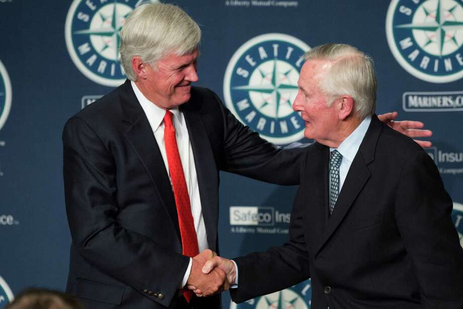Future Mariners chairman John Stanton shakes hands with current chairman and CEO Howard Lincoln following a press conference announcing a change of ownership, at Safeco Field on Wednesday, April 27, 2016. Photo: GRANT HINDSLEY, SEATTLEPI.COM / SEATTLEPI.COM