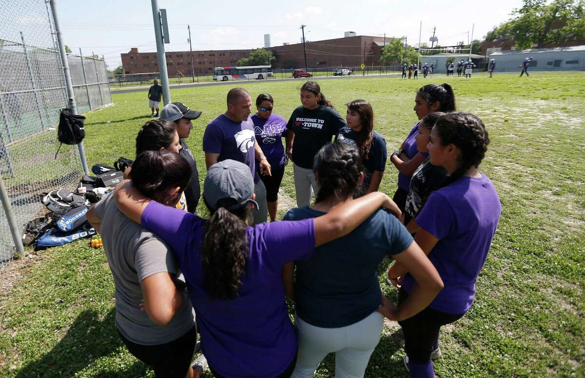 Davis High School softball team head coach Rob Madama, holds a team meeting during practice, Wednesday, April 27, 2016, in Houston. The team was forced to practice on/near the tennis courts because the football team was practicing on the main field. ( Karen Warren / Houston Chronicle )