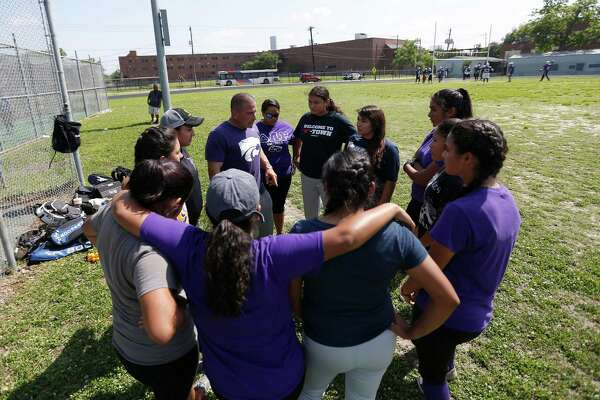 Davis High School softball team head coach Rob Madama, holds a team meeting during practice, Wednesday, April 27, 2016, in Houston. The team was forced to practice on/near the tennis courts because the football team was practicing on the main field.