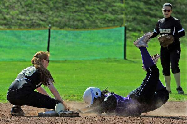 Trumbull Taylor Brown loses the ball as Westhill Kaira Ramon slides into second base in a FCIAC girls softball game at Westhill High School on April 27, 2016. Westhill defeated Trumbull 3-0.