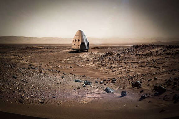 This artist rendering provided by SpaceX shows a Dragon capsule sitting on the surface of Mars. SpaceX is shooting for Mars. The company's billionaire founder and chief executive Elon Musk says he plans to send a Dragon capsule to the red planet as early as 2018. Musk is dubbing his Mars spacecraft Red Dragon. (SpaceX via AP)