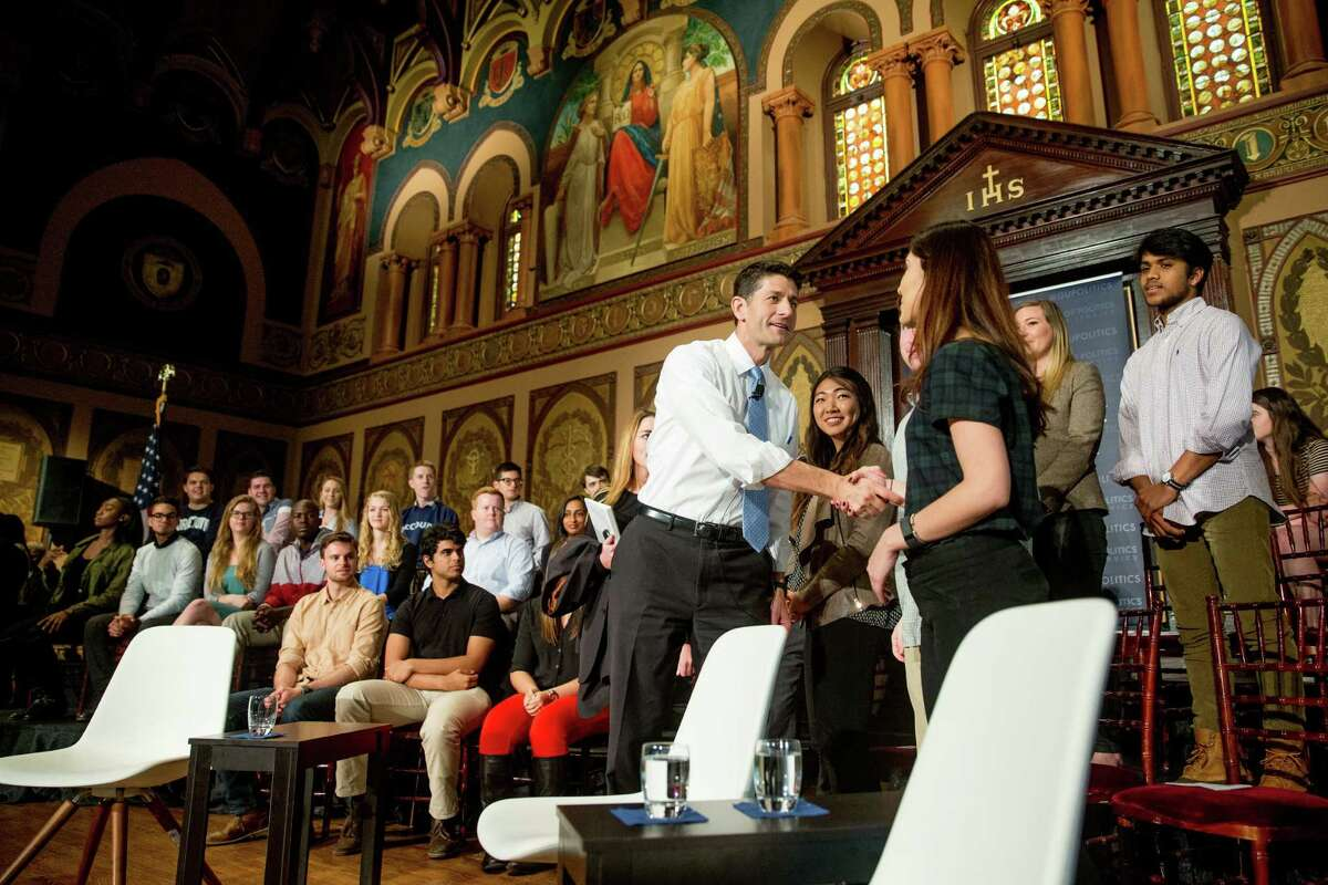 House Speaker Paul Ryan of Wis. greets members of the audience on stage following a town hall at Gaston Hall at Georgetown University in Washington, Wednesday, April 27, 2016. (AP Photo/Andrew Harnik)
