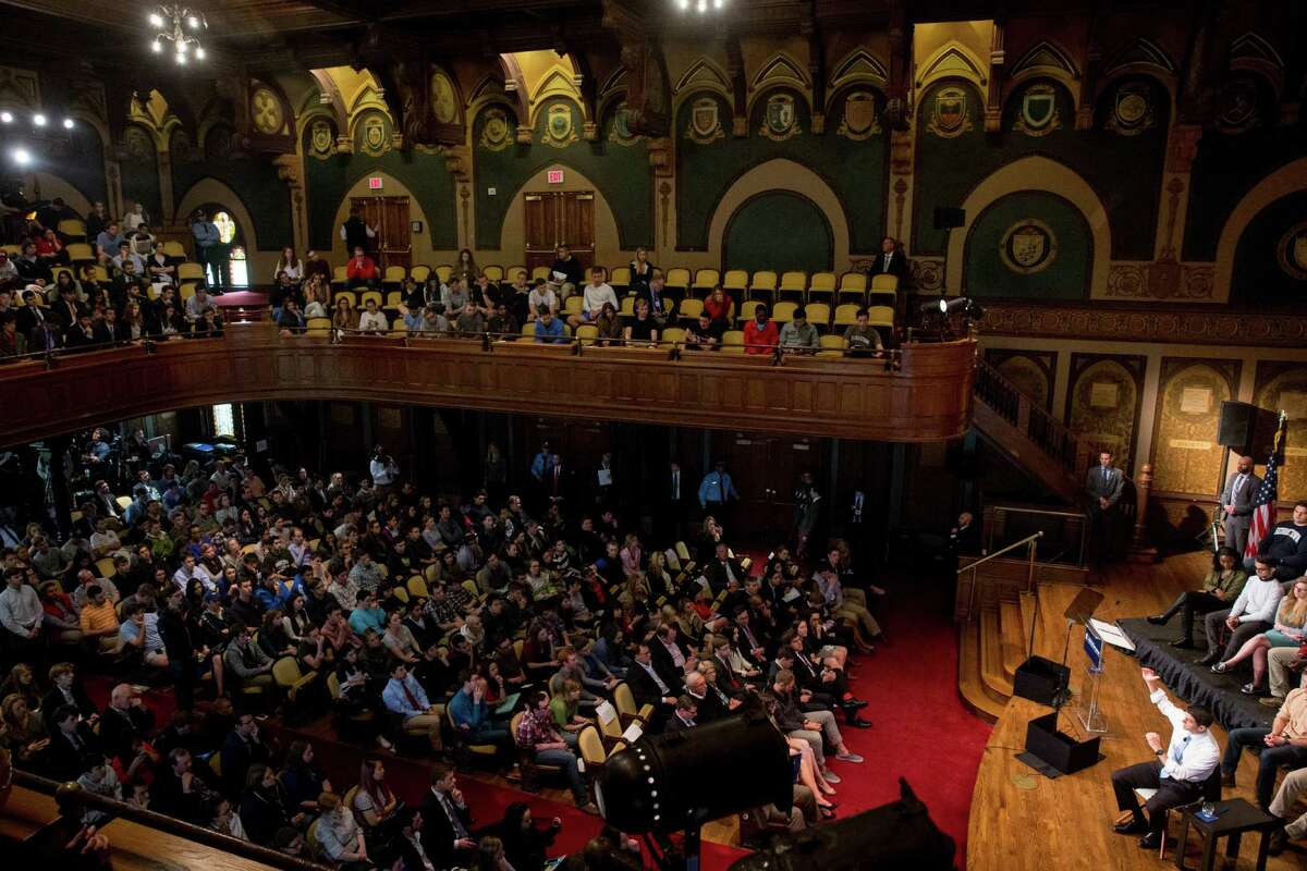 House Speaker Paul Ryan of Wis., bottom right, responds to a question from the audience during a town hall at Gaston Hall at Georgetown University in Washington, Wednesday, April 27, 2016. (AP Photo/Andrew Harnik)