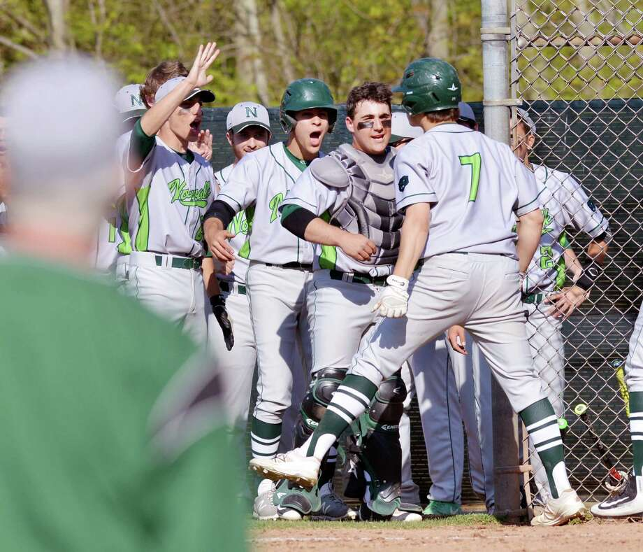 Norwalk's Mike Gonzalez (#7), right, is mobbed by his teammates after hitting what turned out to be the winning two-run homer during the top of the fourth inning of the high school baseball game between Greenwich High School and Norwalk High School at Greenwich, Conn., Wednesday afternoon, April 27, 2016. Norwalk won the game 2-1 over Greenwich as Mike Gonzalez, pictured here, threw a complete game. Photo: Bob Luckey Jr. / Hearst Connecticut Media / Greenwich Time