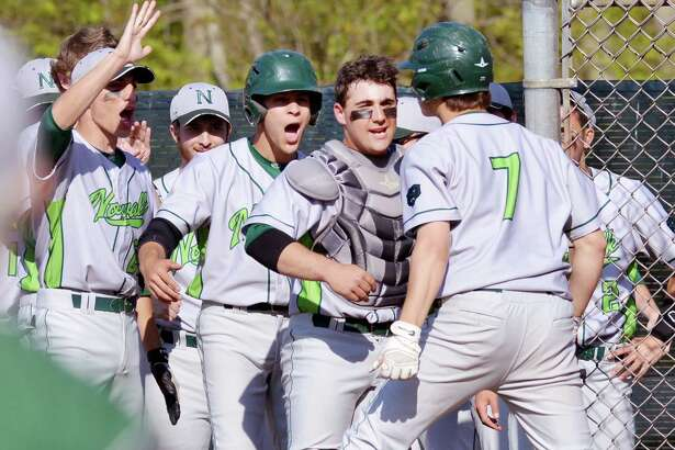 Norwalk's Mike Gonzalez (#7), right, is mobbed by his teammates after hitting what turned out to be the winning two-run homer during the top of the fourth inning of the high school baseball game between Greenwich High School and Norwalk High School at Greenwich, Conn., Wednesday afternoon, April 27, 2016. Norwalk won the game 2-1 over Greenwich as Mike Gonzalez, pictured here, threw a complete game.