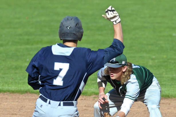 New Milford's Cooper Knight (6) reaches for the ball as Immaculate's James Fahey (7) slides into second in the SWC boys baseball game between New Milford and Immaculate high schools, on Wednesday afternoon, April 27, 2016, at Immaculate High School, in Danbury, Conn. Fahey was out at second.