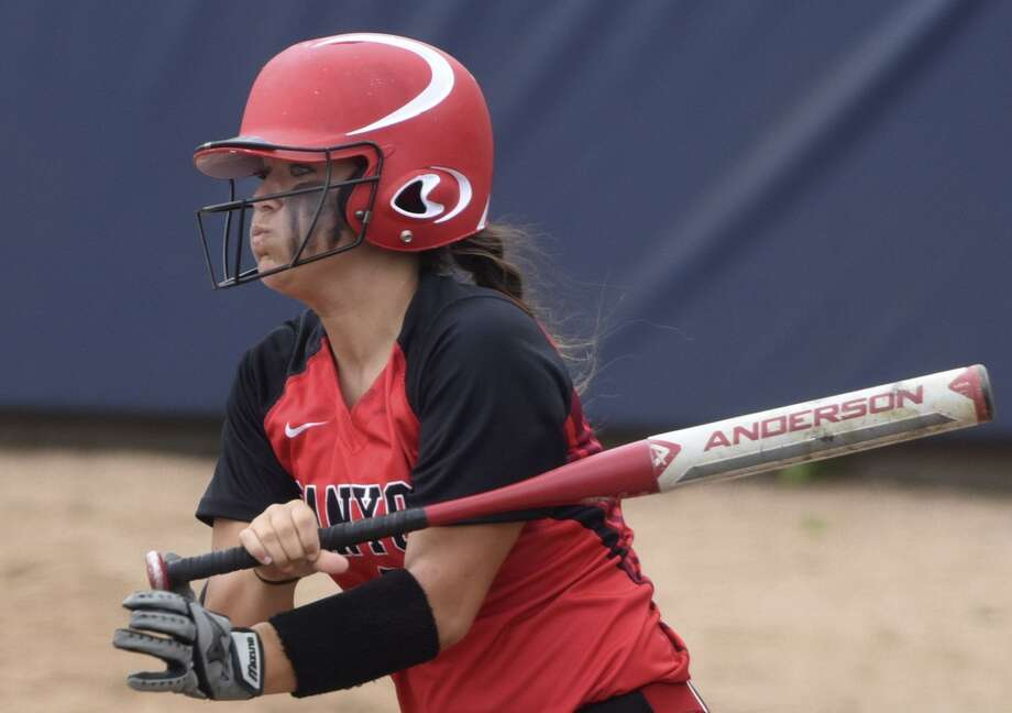Rylee Hopper of New Braunfels Canyon follows through against Eagle Pass during Game 2 of the Class 6A fourth-round softball series at St. Mary's University on Saturday, May 23, 2015. Photo: Billy Calzada /San Antonio Express-News / San Antonio Express-News