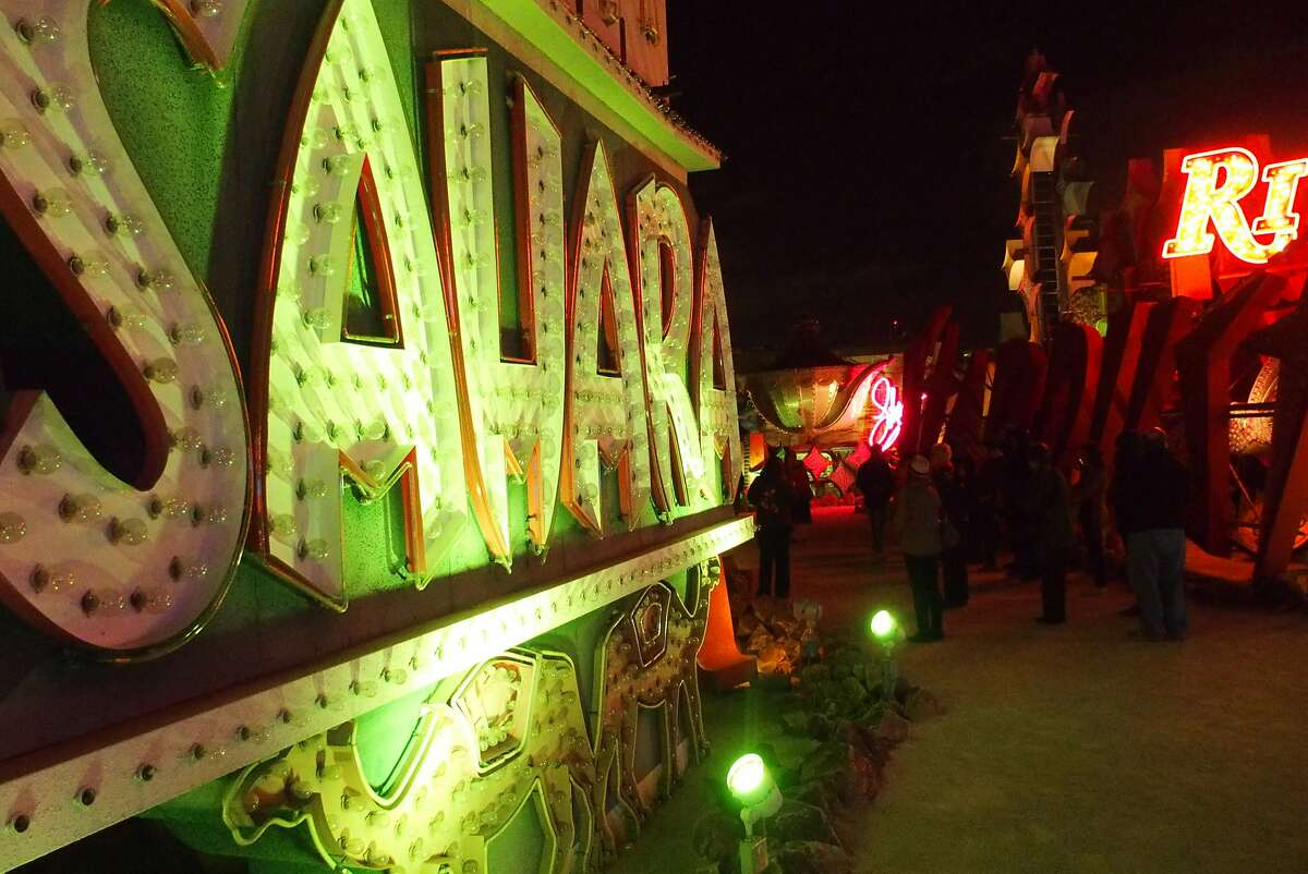 """The """"neon boneyard"""" tour at the Neon Museum features portions of hundreds of neon signs cast off or donated by Las Vegas casinos and businesses."""