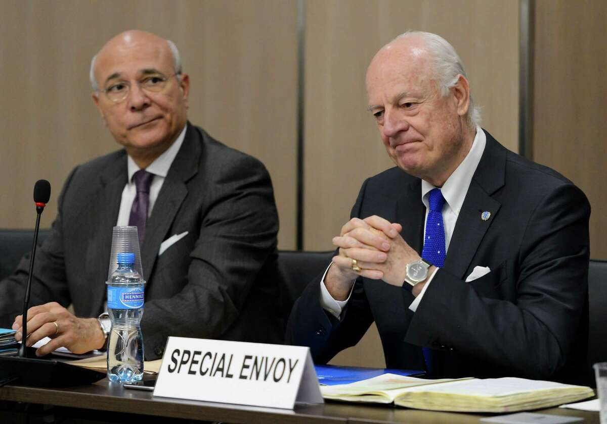 FILE-- In this Fiday April 22, 2016, file photo, UN special envoy for Syria envoy Staffan de Mistura, right, and his deputy Ramzy Ezzeldin Ramzy attend a meeting with the Syrian government delegation during Syria peace talks at the United Nations office in Geneva, Switzerland. A military buildup in northern Syria coupled with heavy fighting and mounting civilian casualties spells the end of a cease-fire that for two months brought much needed relief to war-stricken Syrians, ushering in what could be an even more ruinous chapter in the country's five-year-old conflict. (Fabrice Coffrini/Pool Photo via AP, File)
