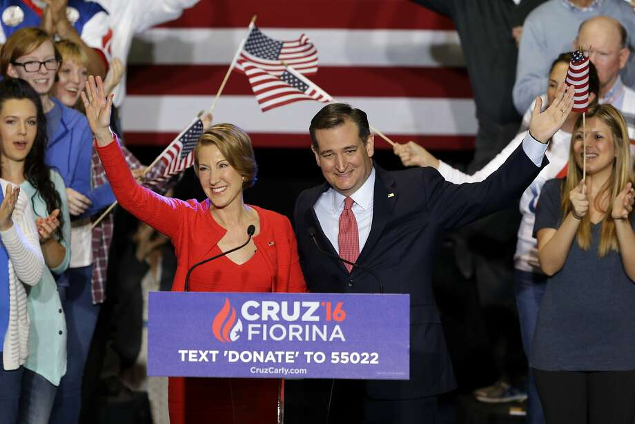 Carly Fiorina and Ted Cruz acknowledge supporters after he announced in Indianapolis that the ex-Hewlett Packard CEO would be  his running mate. Political observers are skeptical that Fiorina will help Cruz's uphill battle to win the Republican presidential nomination. Photo: Michael Conroy, Associated Press