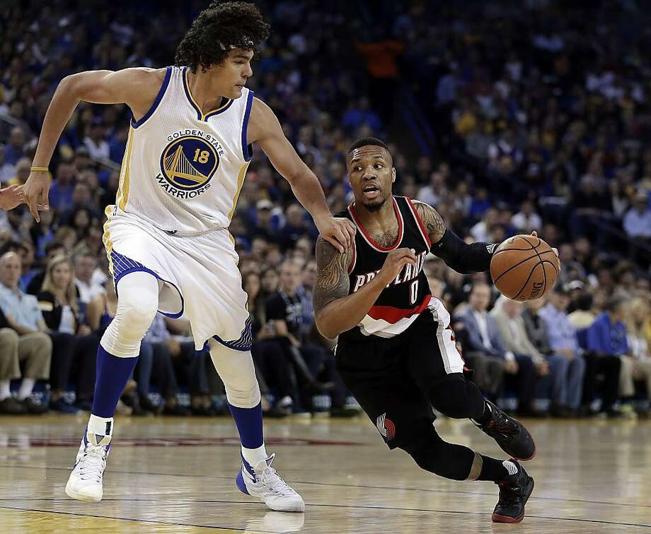 Portland Trail Blazers' Damian Lillard, right, drives the ball against Golden State Warriors' Anderson Varejao (18) during the first half of an NBA basketball game Sunday, April 3, 2016, in Oakland, Calif. (AP Photo/Ben Margot) Photo: Ben Margot, AP