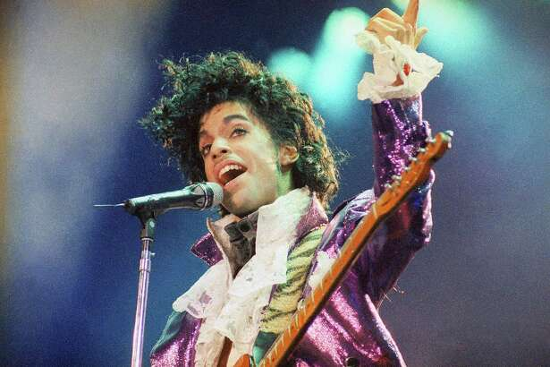 "FILE - In this Feb. 18, 1985 file photo, Prince performs at the Forum in Inglewood, Calif. Prince, widely acclaimed as one of the most inventive and influential musicians of his era with hits including ""Little Red Corvette,"" ''Let's Go Crazy"" and ""When Doves Cry,"" was found dead at his home on Thursday, April 21, 2016, in suburban Minneapolis, according to his publicist. He was 57. (AP Photo/Liu Heung Shing, File) ORG XMIT: NYET417"