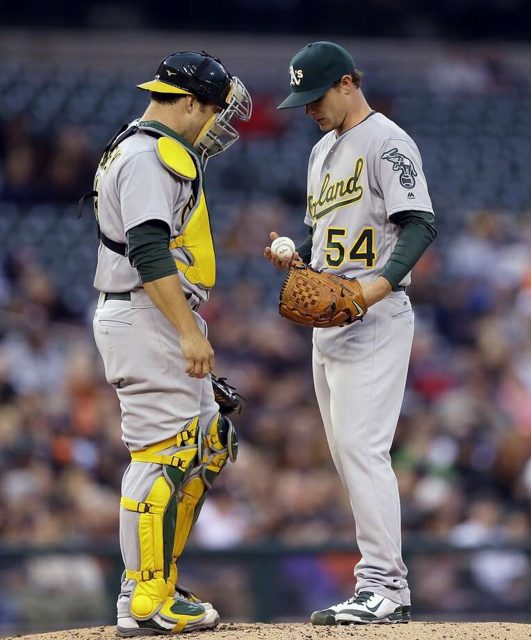 Oakland Athletics catcher Josh Phegley talks with starting pitcher Sonny Gray (54) on the mound during the second inning of a baseball game against the Detroit Tigers, Wednesday, April 27, 2016, in Detroit. (AP Photo/Carlos Osorio) Photo: Carlos Osorio, Associated Press