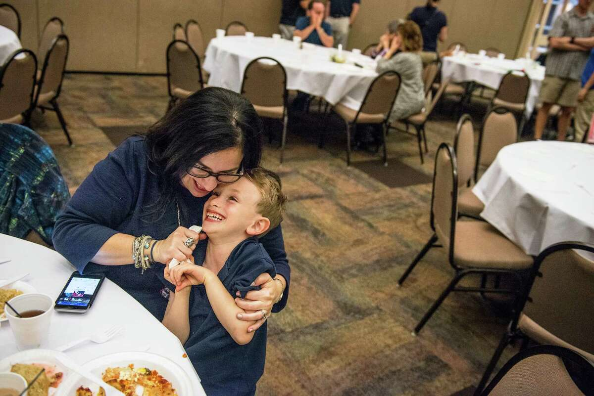 Lauren Abraham plays with her son Benny Abraham, 5, during a Passover meal of Matzah lasagna at Barshop Jewish Community Center of San Antonio on Wednesday, April 27, 2016. The center put on the meal as a way of supporting their community during the stricter dietary days of Passover.