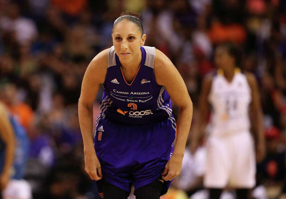 PHOENIX, AZ - JULY 19:  Western Conference All-Star Diana Taurasi #3 of the Phoenix Mercury gets set on defense during the WNBA All-Star Game at US Airways Center on July 19, 2014 in Phoenix, Arizona. The East defeated the West 125-124 in overtime.  (Photo by Christian Petersen/Getty Images) ORG XMIT: 495790801 Photo: Christian Petersen / 2014 Getty Images