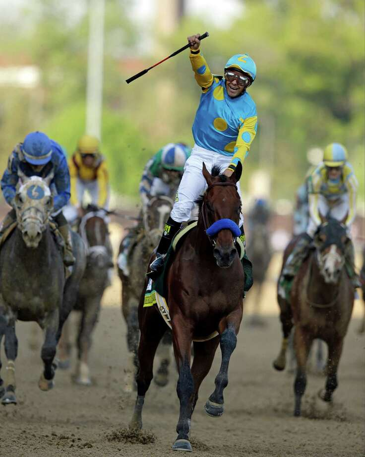 FILE - In this May 2, 2015 file photo, Victor Espinoza rides American Pharoah to victory in the 141st running of the Kentucky Derby horse race at Churchill Downs, in Louisville, Ky. Victor Espinoza will have a chance for an unprecedented three-peat in the Kentucky Derby, after all. The jockey who won the Derby with California Chrome in 2014 and with eventual Triple Crown winner American Pharoah in 2015 has landed aboard long shot Whitmore, Espinoza's agent Brian Beach said Wednesday, April 27, 2016. (AP Photo/Darron Cummings, File) ORG XMIT: NY165 Photo: Darron Cummings / AP