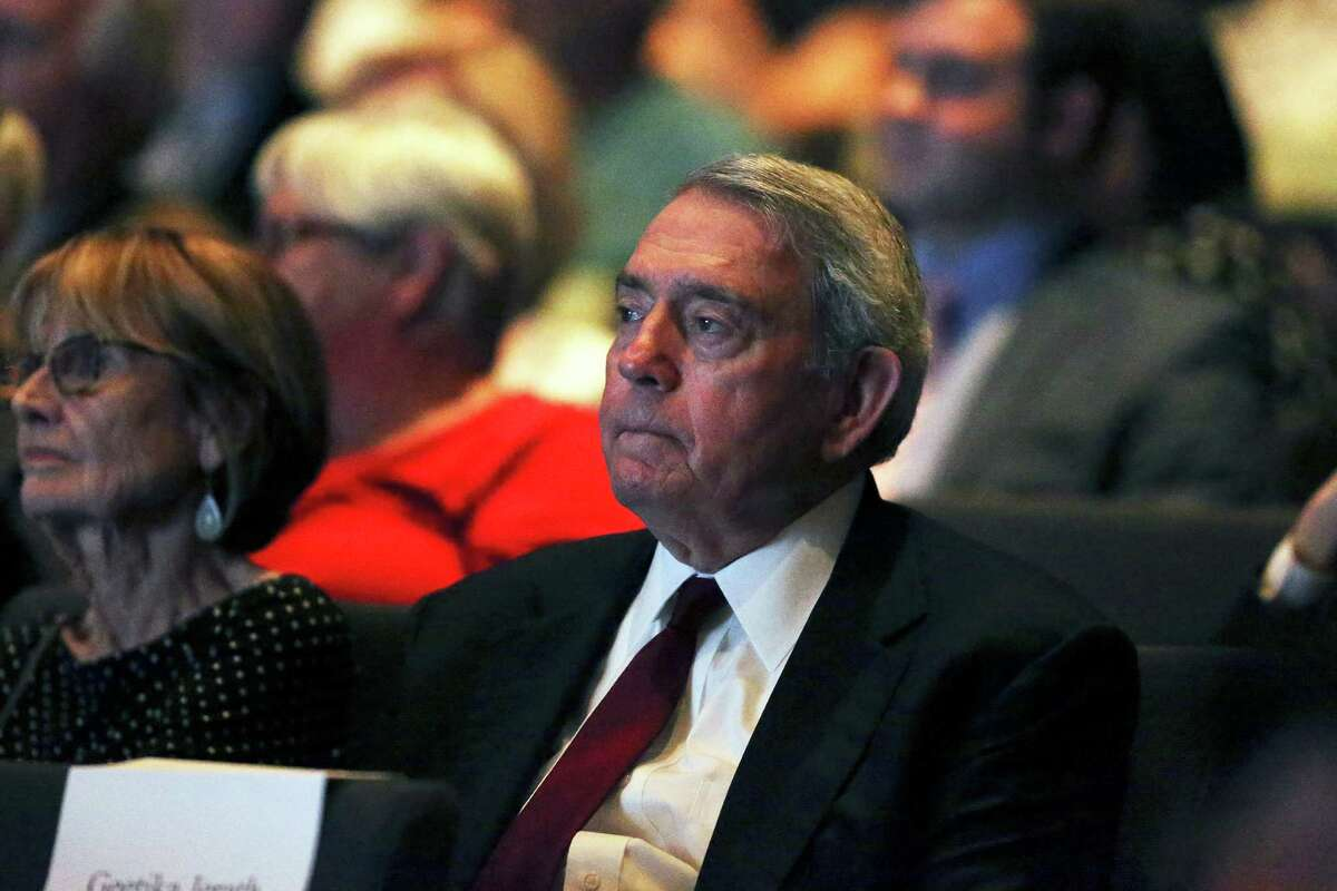 Retired newsman Dan Rather listens from several rows back in the audience as Secretary of State John Kerry answers questions from film maker Ken Burns at the LBJ Library at on April 27, 2016.