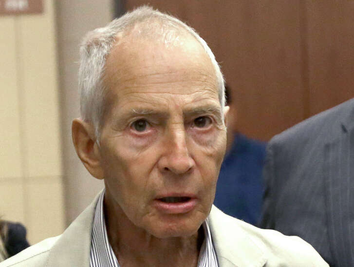 FILE - In this Aug. 15, 2014 file photo, New York City real estate heir Robert Durst leaves a Houston courtroom. New Orleans Federal Judge Kurt Engelhardt on Wednesday, April 27, 2016, approved a plea agreement for Durst to serve 7 years, 1 month in prison on a weapons charge. Durst still faces a separate murder charge in California. (AP Photo/Pat Sullivan, File)