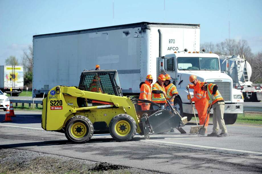 Crews work to repair potholes along Interstate 87 on Wednesday, April 27, 2016, in Bethlehem, N.Y.  The New York State Thruway Authority and the New York State Police Troop T held a press event on Wednesday to announce Operation Work Brake, an annual safety initiative that increases patrols along the Thruway to ensure safer conditions in work zones.  (Paul Buckowski / Times Union) Photo: PAUL BUCKOWSKI / 10036354A