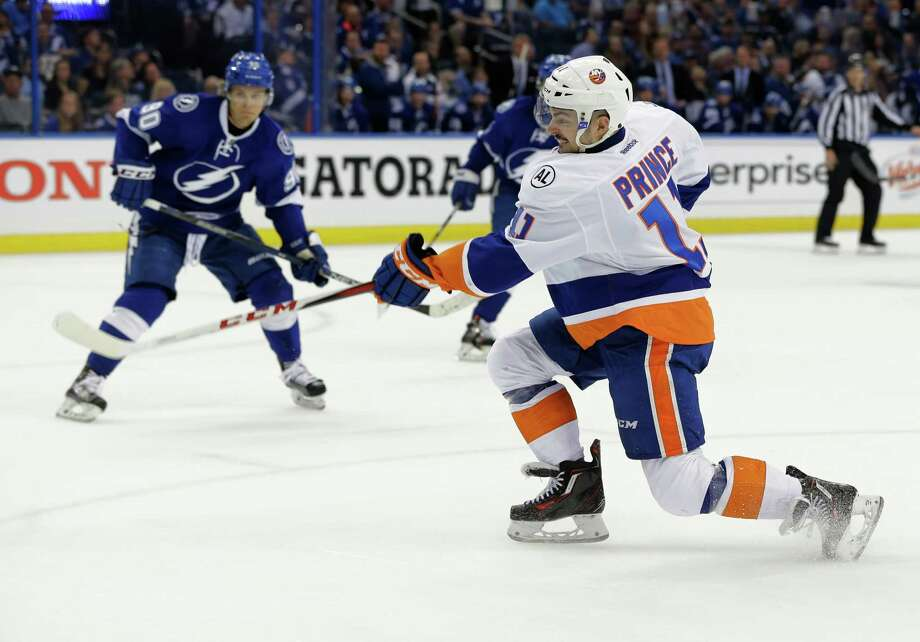 New York Islanders' Shane Prince (11) scores his second goal during the first period of Game 1 of the NHL hockey Stanley Cup Eastern Conference semifinals against the Tampa Bay Lightning, Wednesday, April 27, 2016, in Tampa, Fla. (AP Photo/Chris O'Meara) ORG XMIT: TPA109 Photo: Chris O'Meara / Copyright 2016 The Associated Press. All rights reserved. This m