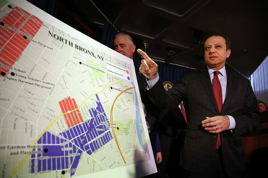 NEW YORK, NY - APRIL 27: Preet Bharara, the United States attorney for the Southern District of New York, gestures at a map showing where 120 people were arrested on gang-related charges on April 27, 2016 in the Bronx borough of New York City. The early morning raid is believed by authorities to be the largest gang takedown in New York City history, affecting members of 2Fly YGz street gang and their rival Big Money Bosses gang. The gangs are accused of being involved in drug and gun sales as well as being responsible for terrorising their respective neighborhoods.  (Photo by Spencer Platt/Getty Images) ORG XMIT: 634312673 Photo: Spencer Platt / 2016 Getty Images