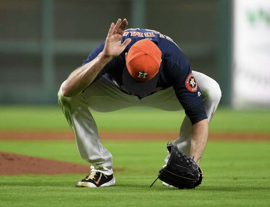 HOUSTON, TX - APRIL 24: Scott Feldman #46 of the Houston Astros reacts after teammate Carlos Correa committed an error with two outs during the third inning against the Boston Red Sox at Minute Maid Park on April 24, 2016 in Houston, Texas. (Photo by Eric Christian Smith/Getty Images) Photo: Eric Christian Smith, Stringer / 2016 Getty Images
