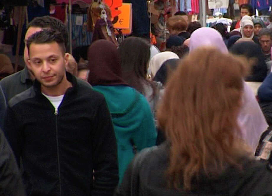 FILE - This Wednesday April 13, 2016 file image taken from video of  of Salah Abdeslam, left,  the fugitive from the Nov. 13 Paris attacks whose capture appears to have precipitated the March 22 bombing in Brussels. Belgian prosecutors confirmed Wednesday April 27, 2016 that Paris attacks suspect Salah Abdeslam was handed over to French authorities.  (TVbrussels via AP) BELGIUM OUT ORG XMIT: TH804 / Tvbrussels