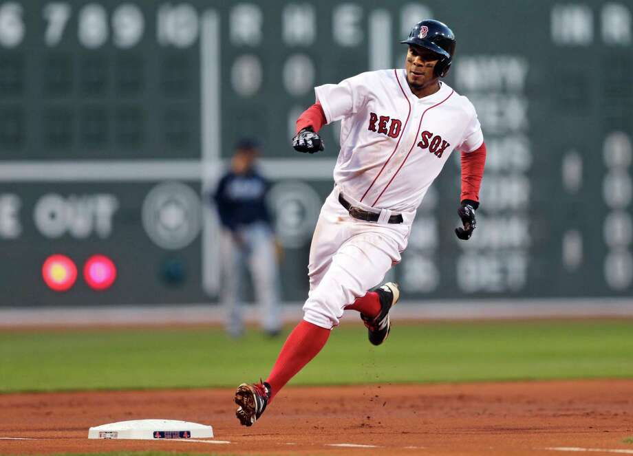 Boston Red Sox's Xander Bogaerts rounds third as he scores on a double by David Ortiz during the first inning of a baseball game against the Atlanta Braves at Fenway Park in Boston, Wednesday, April 27, 2016. (AP Photo/Charles Krupa) ORG XMIT: MACK105 Photo: Charles Krupa / Copyright 2016 The Associated Press. All rights reserved. This m