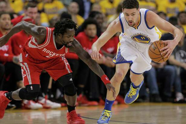 Golden State Warriors Klay Thompson steals the ball from Houston Rockets Patrick Beverley during the first quarter during Round 1 of the NBA Playoff 2016 game at Oracle Arena on Wednesday, April 27, 2016 in Oakland, Calif.