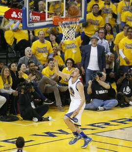 Golden State Warriors Klay Thompson watches his shot after stealing the ball from Houston Rockets Patrick Beverley in the first quarter during Game 5 of the NBA Playoffs at Oracle Arena on Wednesday, April 27, 2016 in Oakland, Calif.