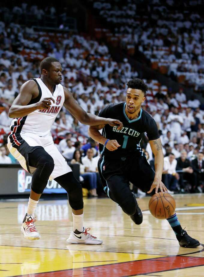 Charlotte Hornets guard Courtney Lee (1) drives past Miami Heat forward Luol Deng (9) during the first half in Game 5 of an NBA basketball playoffs first-round series, Wednesday, April 27, 2016, in Miami. (AP Photo/Wilfredo Lee) ORG XMIT: AAA105 Photo: Wilfredo Lee / Copyright 2016 The Associated Press. All rights reserved. This m