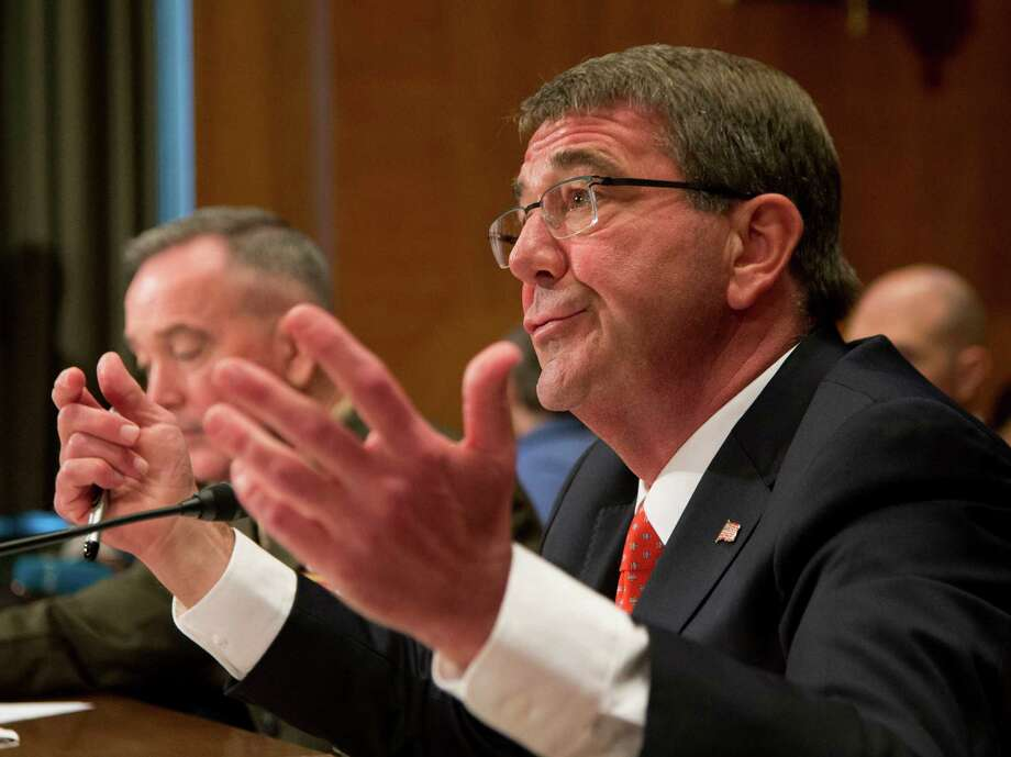 Defense Secretary Ash Carter, right, with Joint Chiefs of Chairman Gen. Joseph Dunford, Jr., testifies on Capitol Hill in Washington, Wednesday, April 27, 2016, before a Senate Defense subcommittee hearing to review the fiscal 2017 Defense Department budget request.  (AP Photo/Manuel Balce Ceneta) Photo: Manuel Balce Ceneta, STF / Copyright 2016 The Associated Press. All rights reserved. This material may not be published, broadcast, rewritten or redistribu