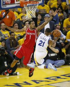 Golden State Warriors Ian Clark goes up for a shot against Houston Rockets Trevor Ariza in the second quarter during Game 5 of the NBA Playoffs at Oracle Arena on Wednesday, April 27, 2016 in Oakland, Calif.
