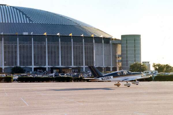 """Dec. 8, 1990: A plane that earlier made an emergency landing at the Astrodome parking lot leaves for its return flight home.    Dr. Douglass Harroun was flying from Austin when his plane ran out of fuel about a mile northeast of the Astrodome. Ellington Field, his destination, was too far so the Dome's parking lot would have to do.     As Harroun later told the Post's David Ellison:     """"This is beautiful,"""" Harroun, 39, said as he later surveyed the Astrodome's vacant north parking lot. """"This is bigger and wider than any runway -- a lot of room. It couldn't be better.""""     About the only thing going on at the time were high school playoff games. Good thing it didn't happen the next day though when the Oilers had a sold-out home game.     The plane was later refueled and flown back to Ellington."""