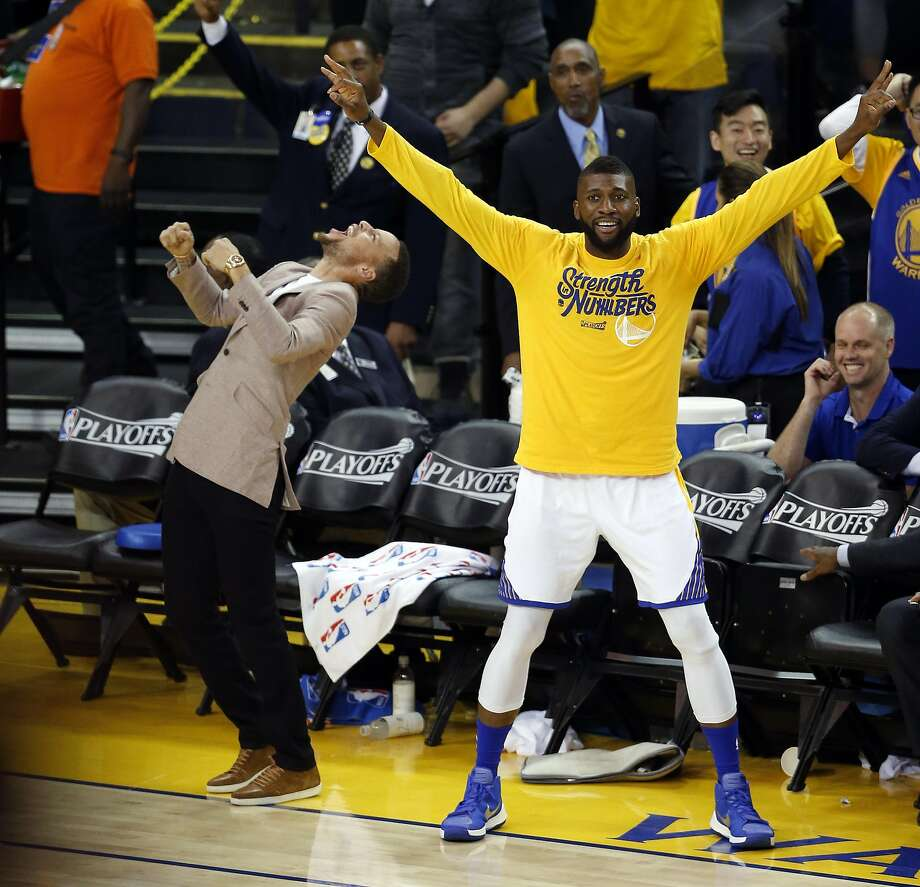 Golden State Warriors' Stephen Curry and Festus Ezeli enjoy a Klay Thompson 3-pointer in 3rd quarter against Houston Rockets in Game 5 of 1st Round of NBA Playoffs at Oracle Arena in Oakland, Calif., on Wednesday, April 27, 2016. Photo: Scott Strazzante, The Chronicle