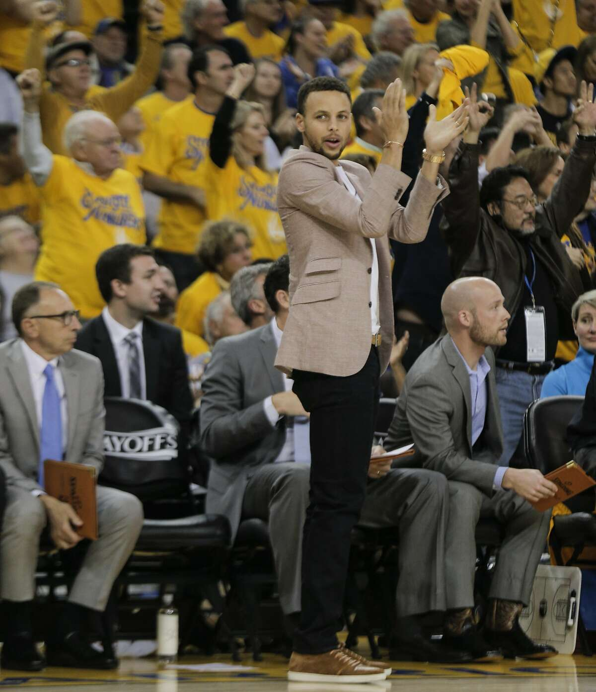 Golden State Warriors Stephen Curry reacts from the bench in Game 5 of the NBA Playoffs at Oracle Arena on Wednesday, April 27, 2016 in Oakland, Calif.