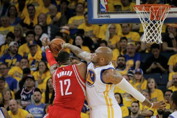 Golden State Warriors Marreese Speights defends against Houston Rockets Dwight Howard in Game 5 of the NBA Playoffs at Oracle Arena on Wednesday, April 27, 2016 in Oakland, Calif.