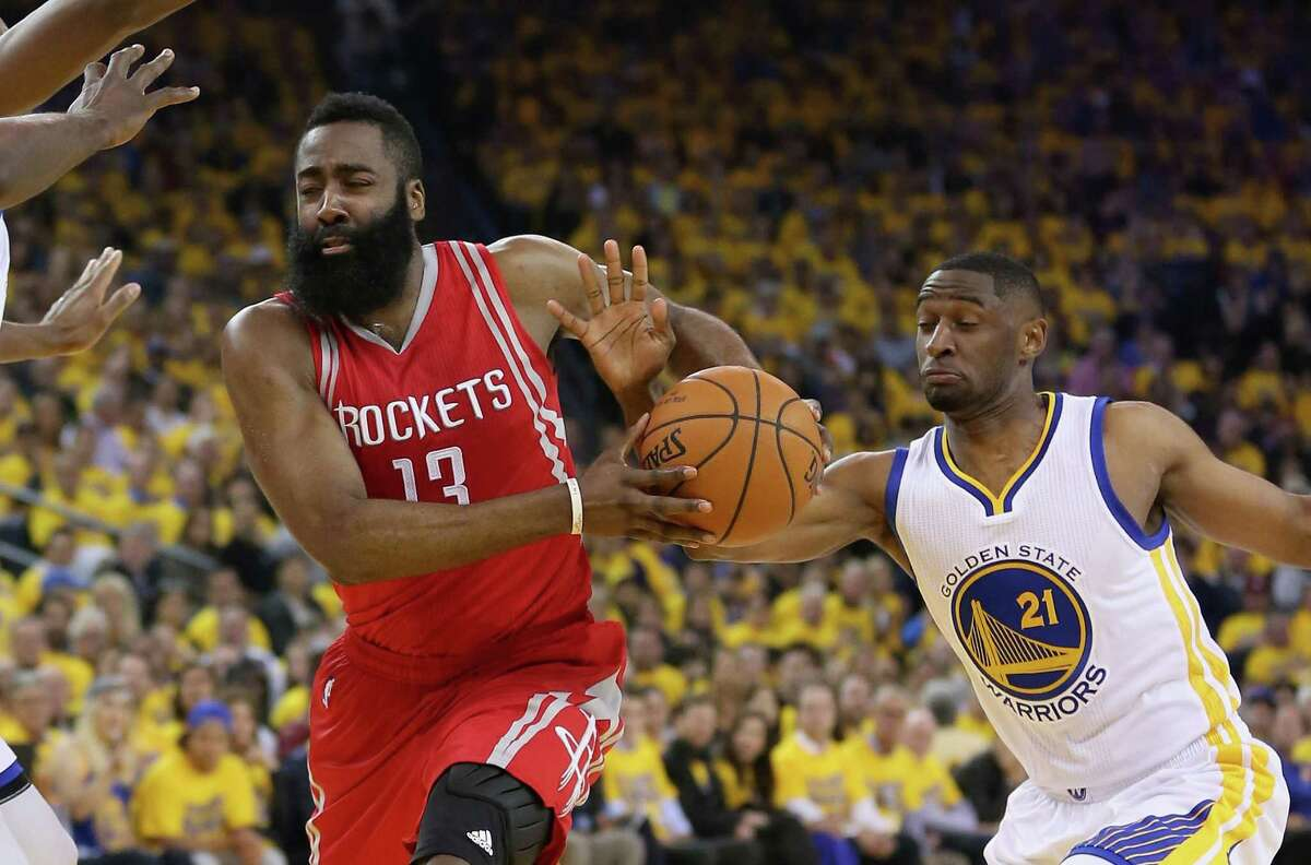 OAKLAND, CA - APRIL 27: James Harden #13 of the Houston Rockets drives on Ian Clark #21 of the Golden State Warriors in Game Five of the Western Conference Quarterfinals during the 2016 NBA Playoffs at ORACLE Arena on April 27, 2016 in Oakland, California.