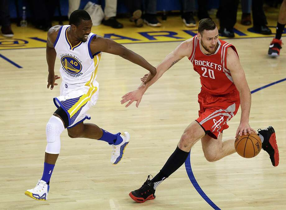 Golden State Warriors' Harrison Barnes, left, guards Houston Rockets' Donatas Motiejunas (20) during the first half in Game 5 of a first-round NBA basketball playoff series Wednesday, April 27, 2016, in Oakland, Calif. (AP Photo/Ben Margot) Photo: Ben Margot, Associated Press / Copyright 2016 The Associated Press. All rights reserved. This material may not be published, broadcast, rewritten or redistribu