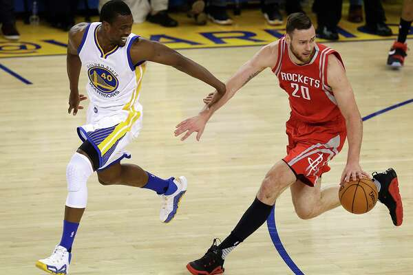 Golden State Warriors' Harrison Barnes, left, guards Houston Rockets' Donatas Motiejunas (20) during the first half in Game 5 of a first-round NBA basketball playoff series Wednesday, April 27, 2016, in Oakland, Calif. (AP Photo/Ben Margot)