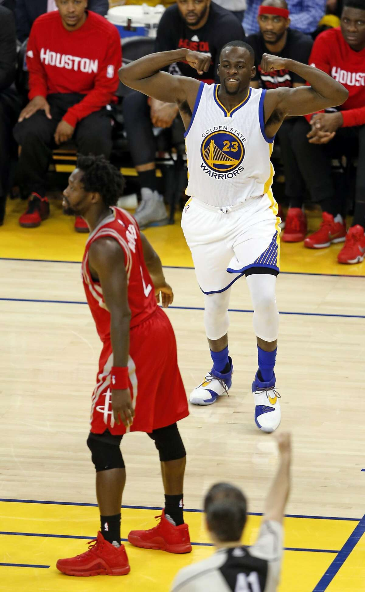 Golden State Warriors' Draymond Green shows his Superman pose after scoring and being fouled by Houston Rockets' Patrick Beverley 3rd quarter of Warriors' 114-81 win in Game 5 of the first round of the NBA Playoffs at Oracle Arena in Oakland, Calif., on Wednesday, April 27, 2016.