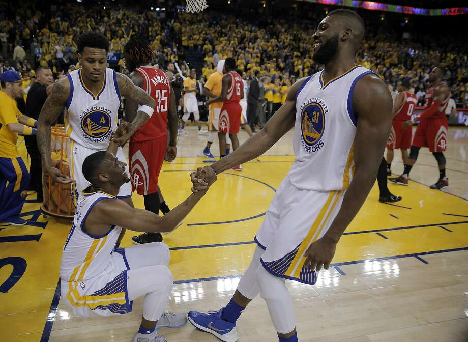 Brandon Rush (4) and Festus Ezeli help Ian Clark off the floor after he fell on the Rockets' last possession. Rush and Clark didn't play that much in the regular season, but they enjoyed key moments in the series win over Houston. Photo: Carlos Avila Gonzalez, The Chronicle