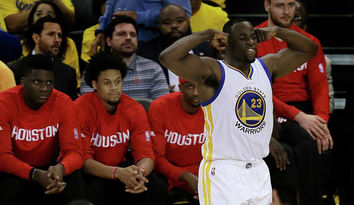 Golden State Warriors' Draymond Green (23) celebrates a score against Houston Rockets during the second half in Game 5 of a first-round NBA basketball playoff series Wednesday, April 27, 2016, in Oakland, Calif. The Warriors won 114-81 and advanced to the second round of the playoffs.(AP Photo/Ben Margot)