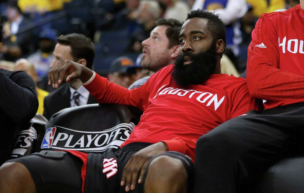 OAKLAND, CA - APRIL 27: James Harden #13 of the Houston Rockets sits on the bench during the final minutes of their loss to the Golden State Warriors in Game Five of the Western Conference Quarterfinals during the 2016 NBA Playoffs at ORACLE Arena on April 27, 2016 in Oakland, California.