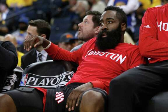 OAKLAND, CA - APRIL 27:  James Harden #13 of the Houston Rockets sits on the bench during the final minutes of their loss to the Golden State Warriors in Game Five of the Western Conference Quarterfinals during the 2016 NBA Playoffs at ORACLE Arena on April 27, 2016 in Oakland, California. NOTE TO USER: User expressly acknowledges and agrees that, by downloading and or using this photograph, user is consenting to the terms and conditions of Getty Images License Agreement.