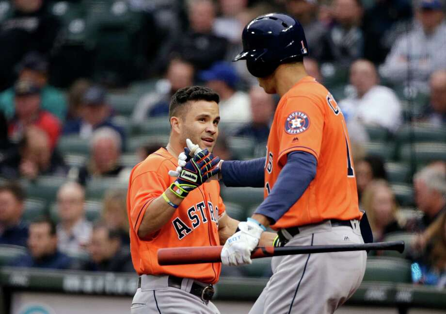 Houston Astros' Jose Altuve, left, is congratulated on his home run against the Seattle Mariners by Carlos Correa in the first inning of a baseball game Wednesday, April 27, 2016, in Seattle. (AP Photo/Elaine Thompson) Photo: Elaine Thompson, STF / AP