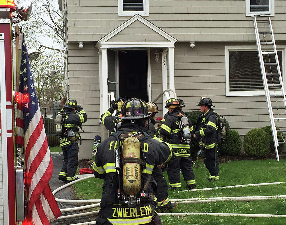Firefighters at the scene of an Alden Street home were a smoky kitchen fire was extinguished. Photo: Fairfield Fire Department / Fairfield Fire Department / Fairfield Citizen